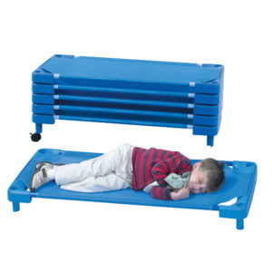 kid sleeping on rest cot