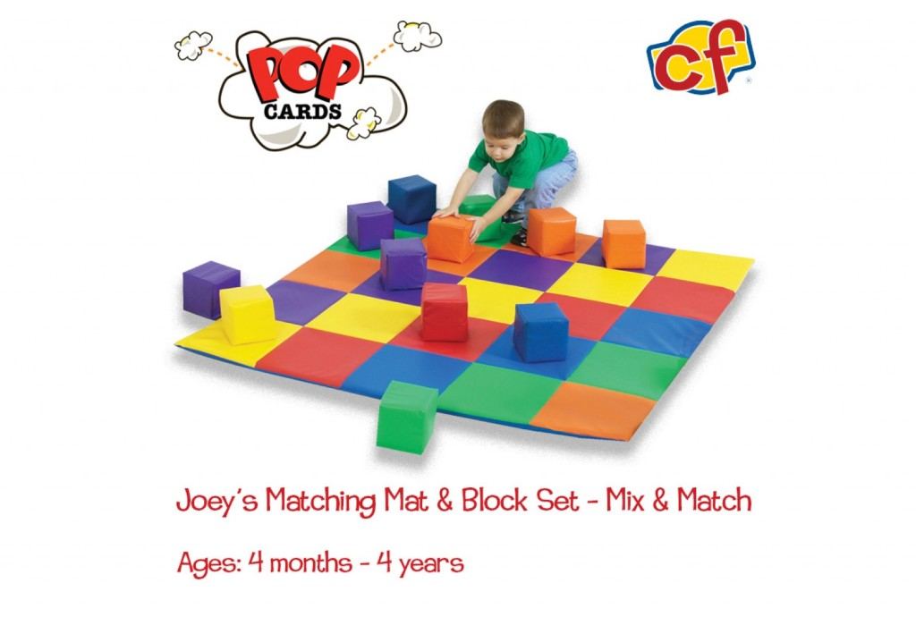 boy playing with matching mat and block set