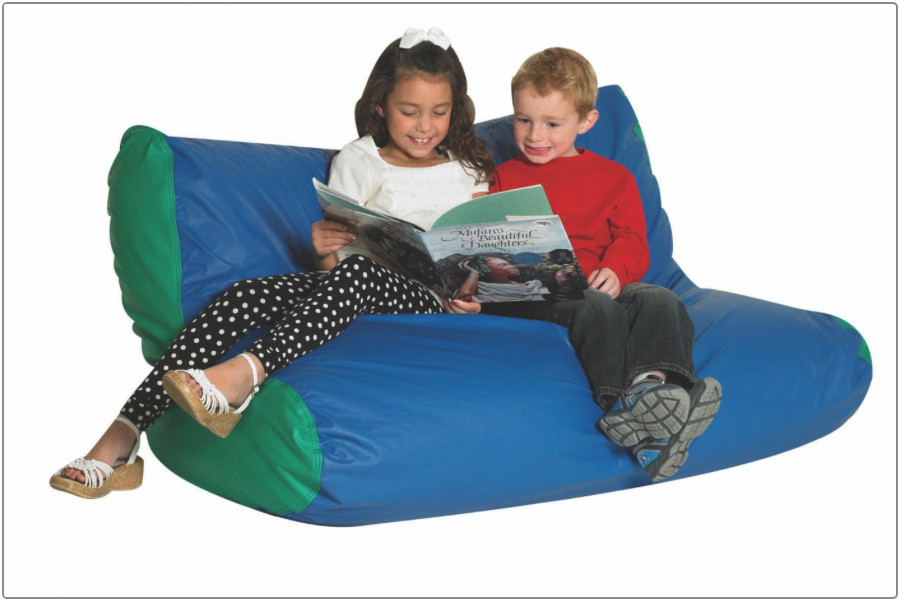 children reading on large soft chair