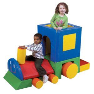 children on train block set