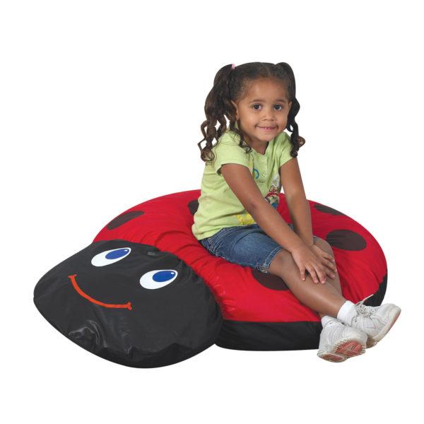 girl on ladybug seat