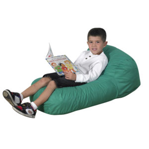 child sitting on green soft chair