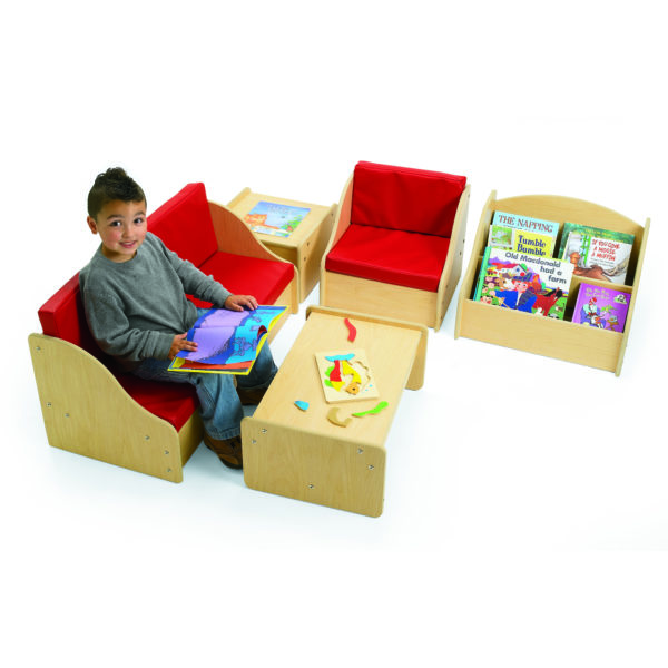 boy sitting in childrens living room set