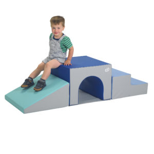 Child sitting on tunnel climber