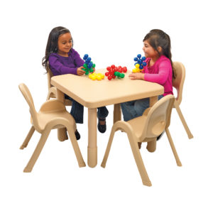 children sitting at large tan square value table