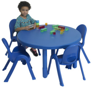 children sitting at blue round value table