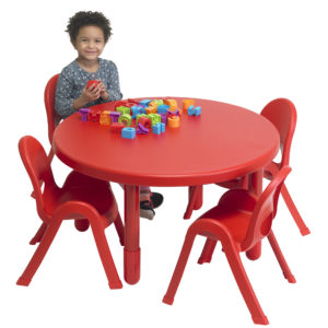 child sitting at red round value table