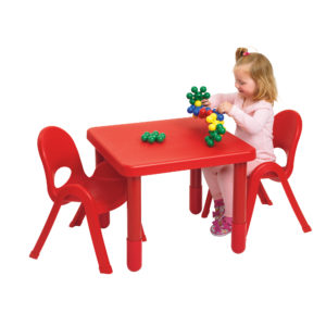 girl sitting on red square value table
