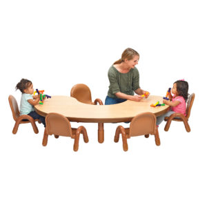 teacher with kids at natural wood kidney table